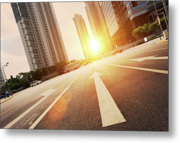 Road In City With Sunset Metal Print by Loveguli