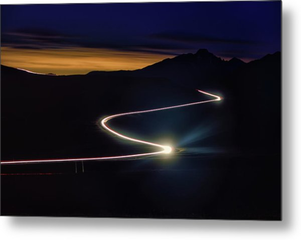 Road With Headlights In Rocky Mountain Metal Print