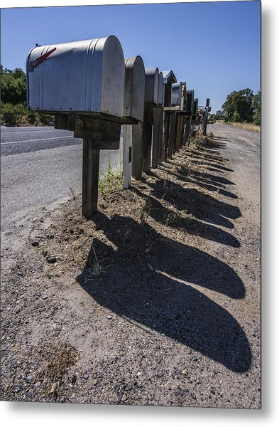 Row Of Mailboxes And Shadows Metal Print by David Litschel