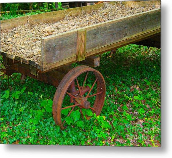 Rusted Wagon Wheel Metal Print