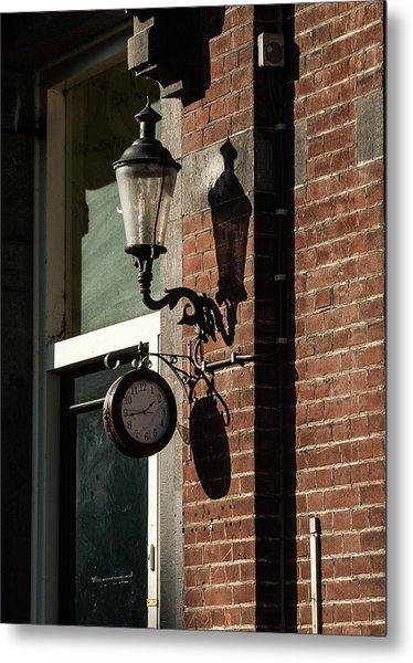 Rustic Wall Clock Against Facade Metal Print
