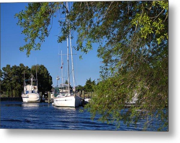Sailboat Through Trees Metal Print