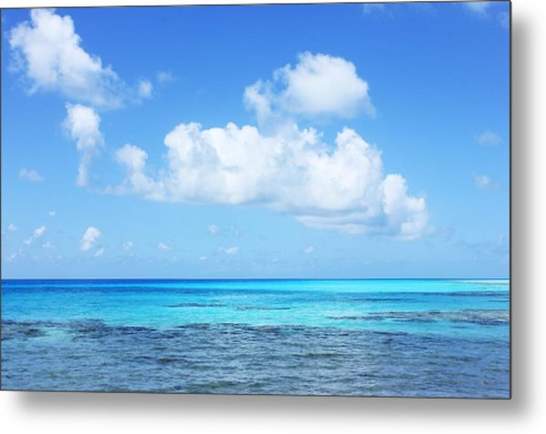 Scenic View Of Turquoise Sea Against Sky Metal Print by Fred Bahurlet / Eyeem