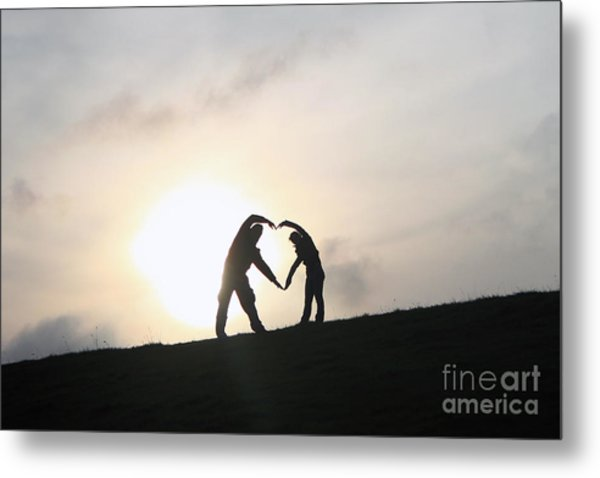 Silhouette Couple Forming A Heart Metal Print by Lars Ruecker