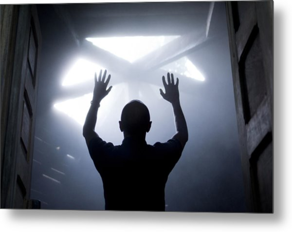 Silhouette Of A Man With Raised Hands Against Light Coming From Above. Metal Print by Maciej Toporowicz, NYC