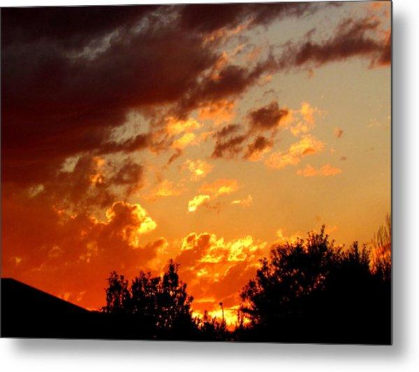 Sky On Fire. Metal Print by Joyce Woodhouse