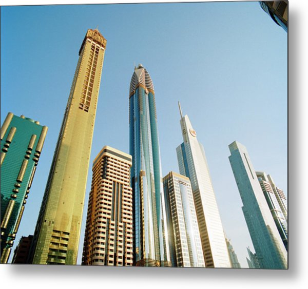 Skyscrapers Along Sheikh Zayed Road At Metal Print by Gary Yeowell