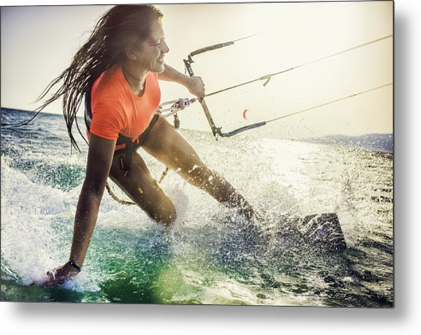 Smiling Young Female Kiteboarder On The Sea Metal Print by Vm