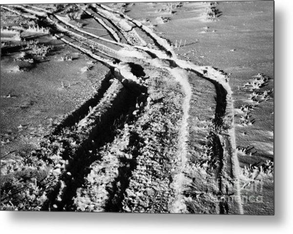 snowmobile tracks in snow across frozen field Canada Metal Print by Joe Fox