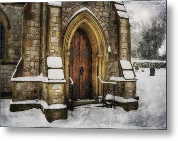 Snowy Church Door Metal Print
