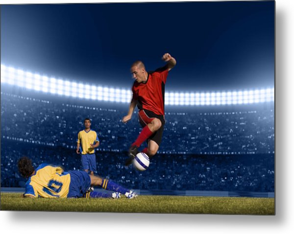 Soccer Player Jumping With Ball Metal Print by Kycstudio