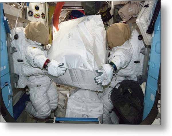 Spacesuits On The Iss Metal Print