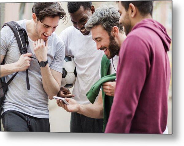 Sports Guys With Smart Phone Having Fun Metal Print by Hinterhaus Productions