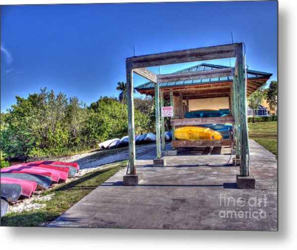 Storing The Canoes Metal Print by Ines Bolasini