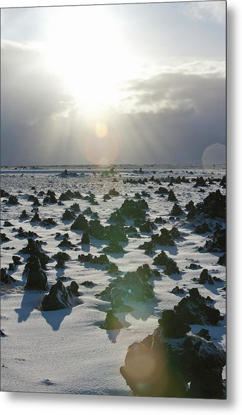 Sun Shining On A Field Of Lava Rocks Metal Print by Thomas Kokta