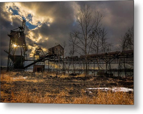 Sunlight Through A Coal Loader Metal Print