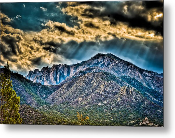 Sunrays Over The Capitans Metal Print by Helene Kobelnyk