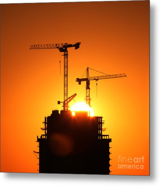 Sunrise Cranes On Building Metal Print
