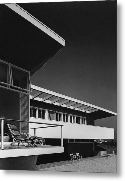 The Exterior Of A Beach House Metal Print by Robert M. Damora