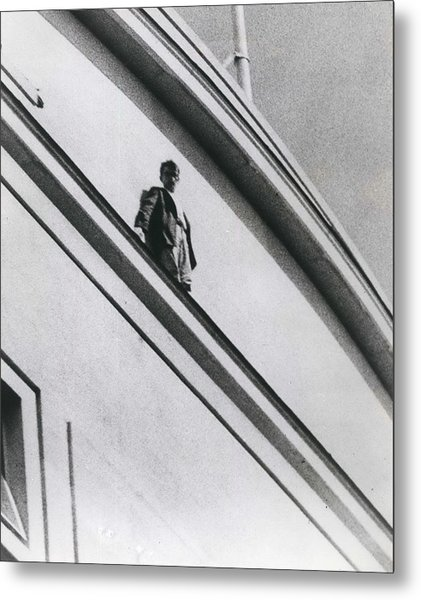 The Man In Love Is Saved From A Parapet Metal Print by Retro Images Archive