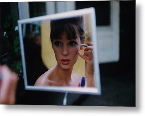 The Reflection Of A Model Applying Make-up Metal Print by Karen Radkai