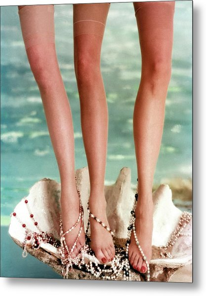 Three Legs Standing In A Shell Metal Print by John Rawlings