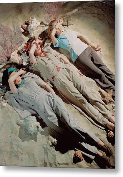 Three Models Lying Down On Sand Metal Print by John Rawlings