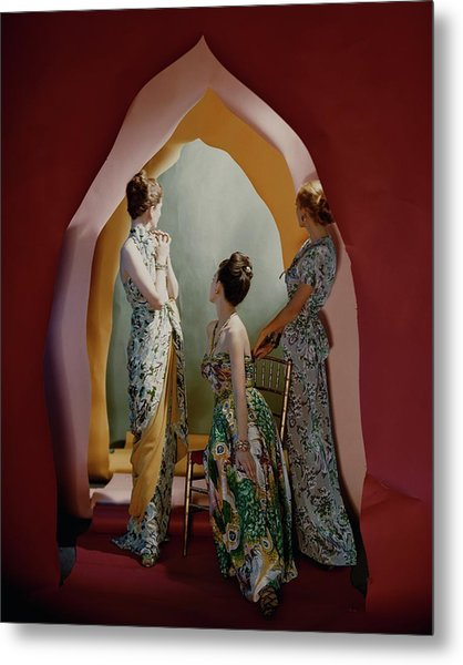 Three Models Wearing Patterned Dresses Metal Print