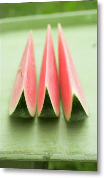 Three Wedges Of Watermelon On Green Table Metal Print