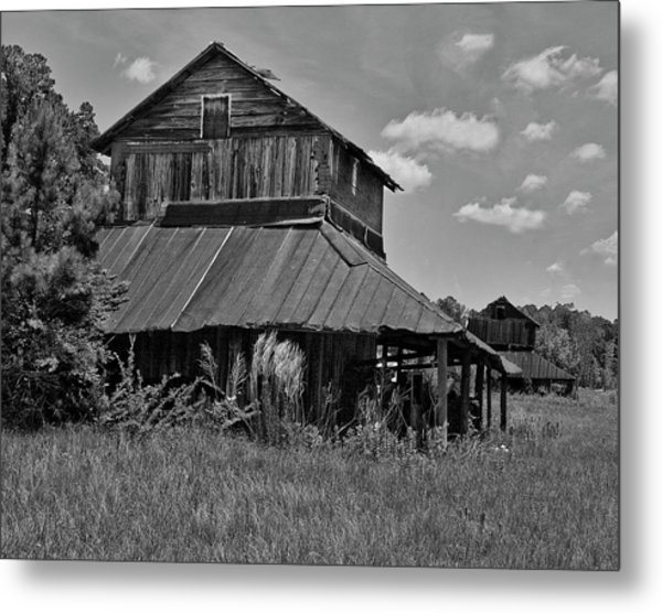 Tobacco Barns With Clouds Metal Print