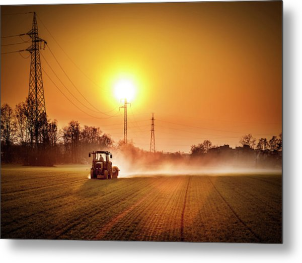 Tractor In A Field At Sunset Metal Print by Rinocdz
