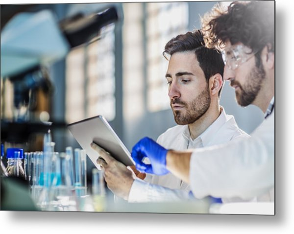 Two Scientist Using Digital Tablet In Laboratory Metal Print by Poba