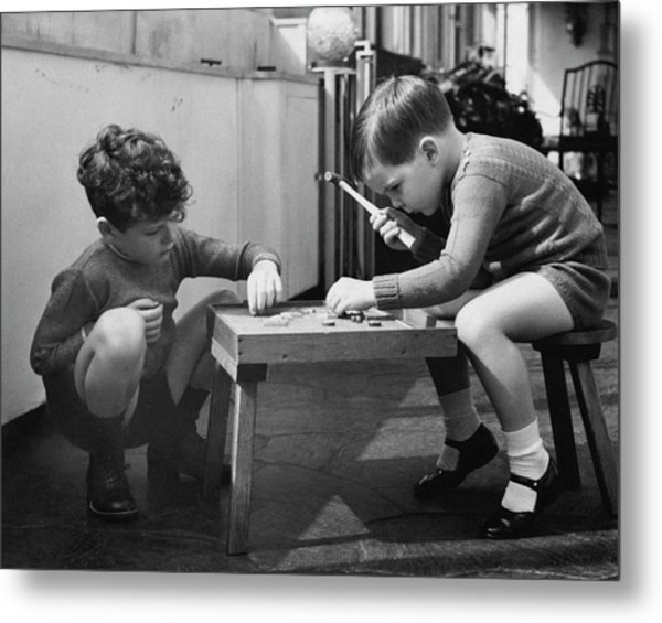 Two Young Boys Sitting By A Wooden Table Metal Print