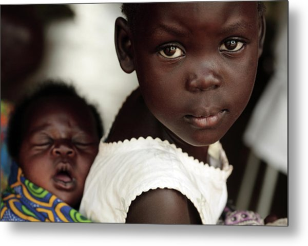 Ugandan Girl Carrying A Baby Metal Print