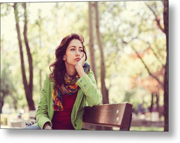 Unhappy Girl Sitting At Bench Metal Print by Martin Dimitrov