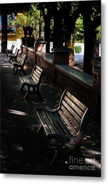 unoccupied park benches in the shade of trees in Palestrina Metal Print