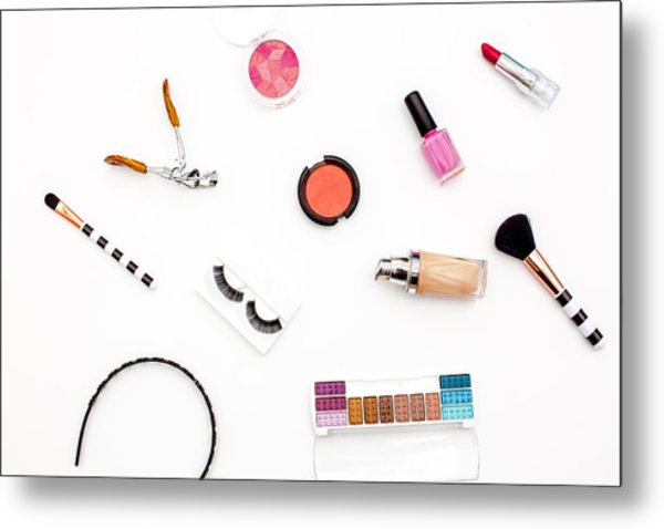 various makeup products and cosmetics in white background.Top view Metal Print by Carol Yepes