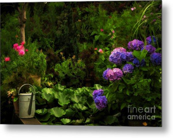 Watering Can In A Beautiful Garden Metal Print