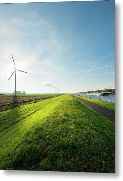 Wind Turbines And Canal, Bath, Zeeland Metal Print by Mischa Keijser