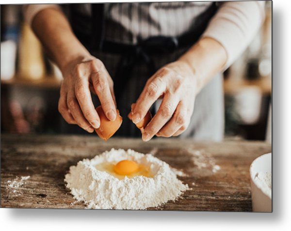 Woman Adds An Egg To The Flour Metal Print by Anchiy