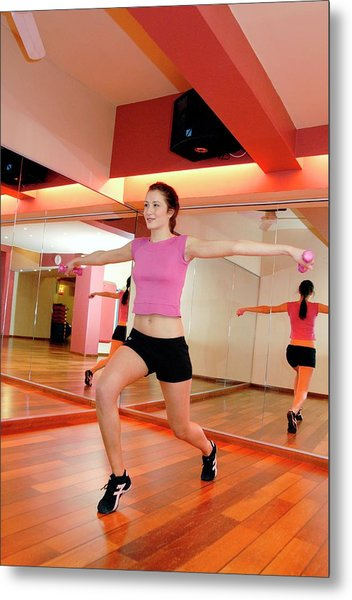 Woman Exercising In A Gym Metal Print by Aj Photo/science Photo Library