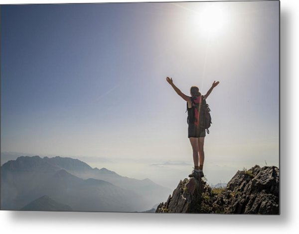 Woman Exulting On A Mountaintop Metal Print by Buena Vista Images
