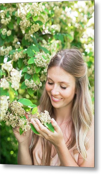 Woman Holding White Flowers Metal Print by Ian Hooton/science Photo Library