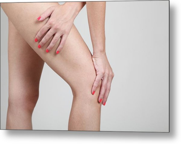 Woman Massages Her Painful Knee Metal Print by Photostock-israel