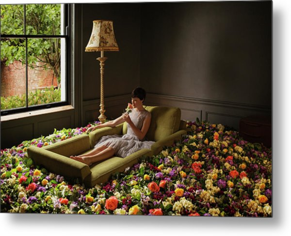 Woman Sitting On Sofa Surrounded By Metal Print by Anthony Harvie