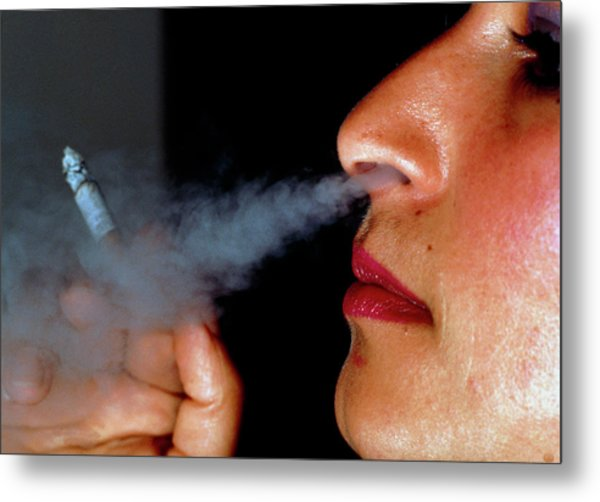Woman Smoking A Cigarette Metal Print by Harvey Pincis/science Photo Library