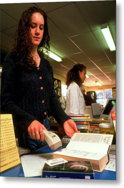 Woman Using A Bar Code Scanner In A Library Metal Print