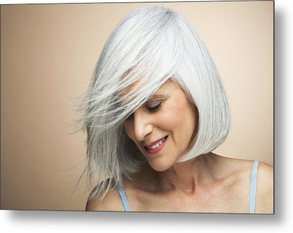 Woman With A Silvery,grey Bob Looking Down. Metal Print by Andreas Kuehn