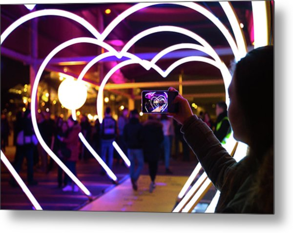 Woman With Smartphone Taking Picture Of Metal Print by Artur Debat