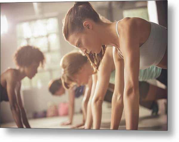 Women Working Out In Exercise Class Metal Print by John Fedele